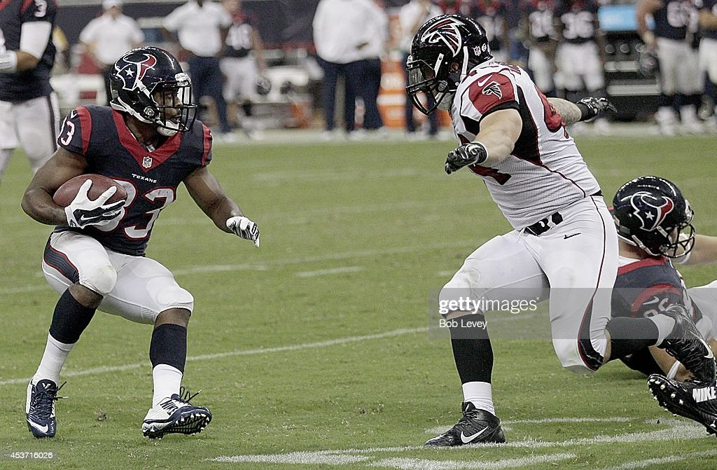 William Powell #33 of the Houston Texans runs up against Pat Angerer #44 of the Atlanta Falcons in the fourth quarter in a pre-season NFL game on August 16, 2014 at NRG Stadium in Houston, Texas.