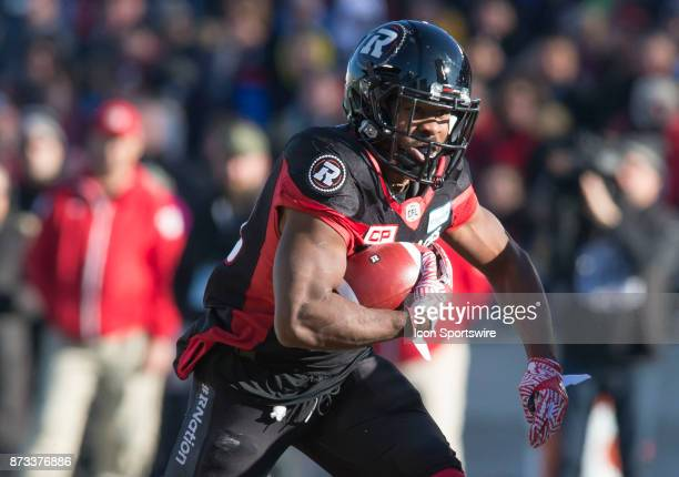 William Powell of the Ottawa Redblacks carries the ball against the Saskatchewan Roughriders in Canadian Football League play during the CFL East...