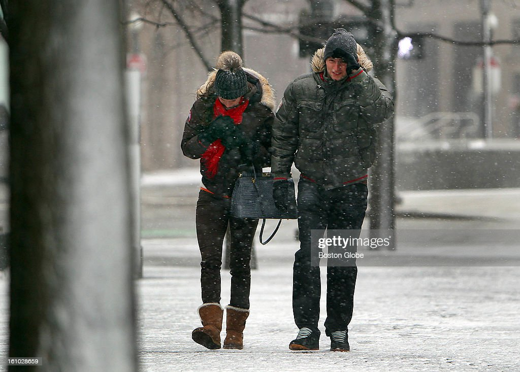 William Pownall and his friend Julie Selz were on their way to the New England Aquarium. Both live in Switzerland. 'This is crazy,' Pownall said as they walked into a strong wind.