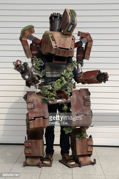 William Roberts dressed as Bastion from 'Overwatch' poses for a photograph on the second day of the London 'MCM Comic Con' at the ExCel centre in...