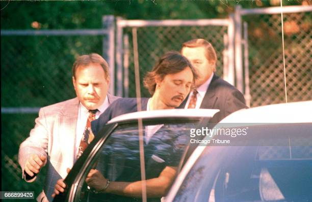 William Rouse is taken away by Lake County Sheriff's Police after appearing in juvenile court on Oct 16 1995 Rouse was charged with killing his...