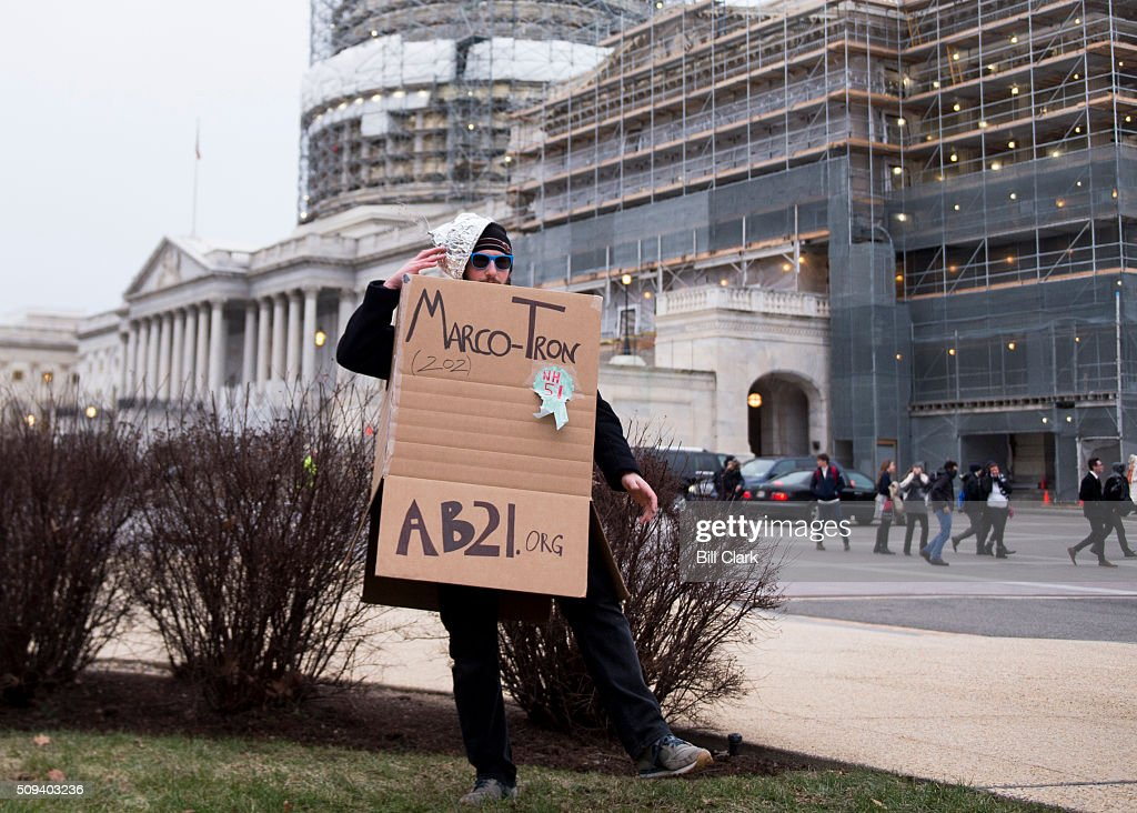 William Schoell, with the American Bridge PAC, dresses up as a robot named 'Marco-Tron' to greet Sen. Marco Rubio as he returns to the Capitol for a vote on North Korea sanctions on Wednesday, Feb. 10, 2016.