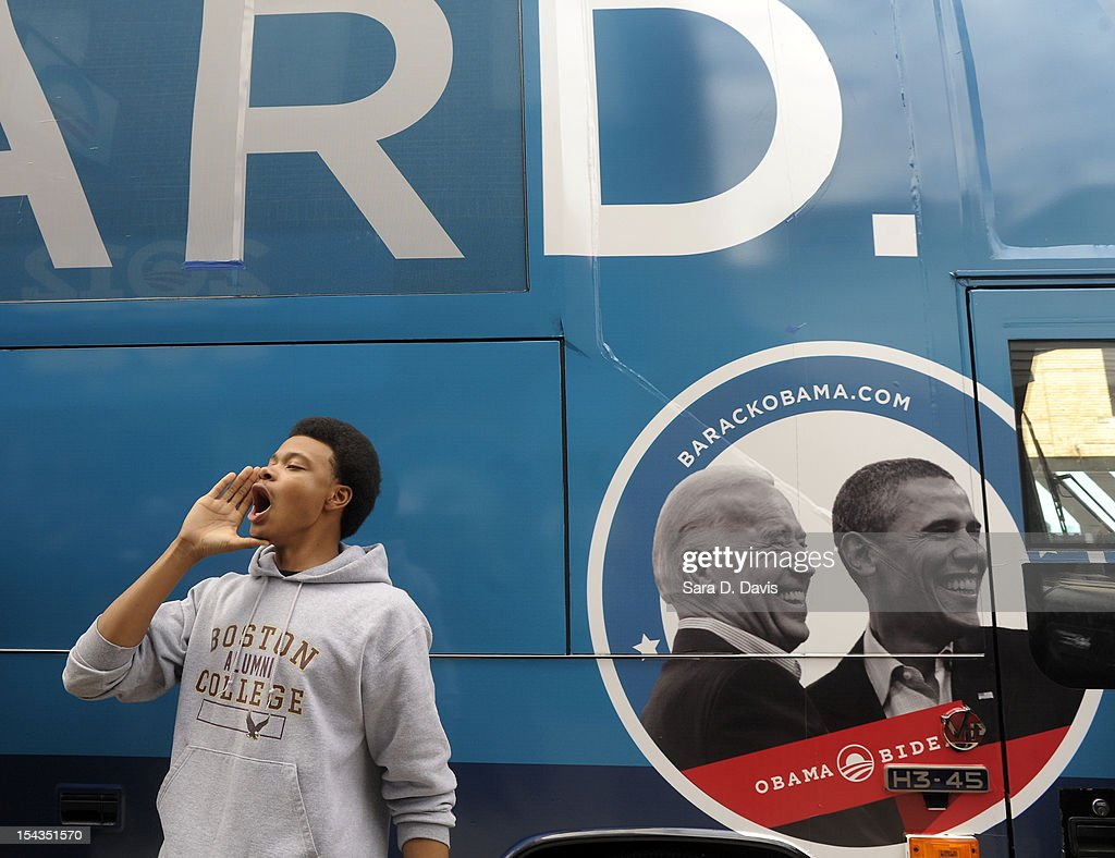 William Seabreeze, 19 of Wilson, leads a chant outside the Democratic National Committee and Obama for America ÒGotta VoteÓ Bus on October 18, 2012 in Wilson, North Carolina. The DNC/OFA Bus is on a month long tour spending through the end of the week in North Carolina. Today is the first day to vote for the election in North Carolina. Early voting is offered at select location from now through November 3.
