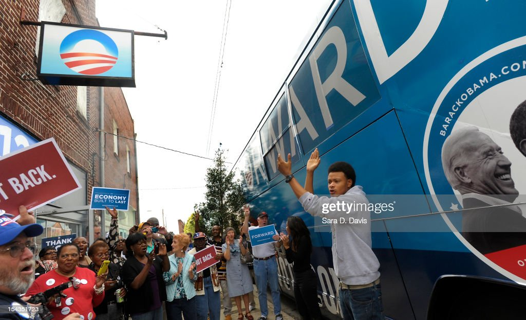 William Seabreeze (right), 19 of Wilson, leads a chant to a waiting crowd outside the Democratic National Committee and Obama for America ÒGotta VoteÓ Bus on October 18, 2012 in Wilson, North Carolina. The DNC/OFA Bus is on a month long tour spending through the end of the week in North Carolina. Today is the first day to vote for the election in North Carolina. Early voting is offered at select location from now through November 3.