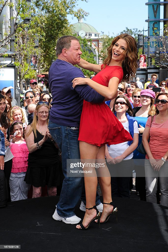 William Shatner (L) and Maria Menounos dance together at 'Extra' at The Grove on April 25, 2013 in Los Angeles, California.