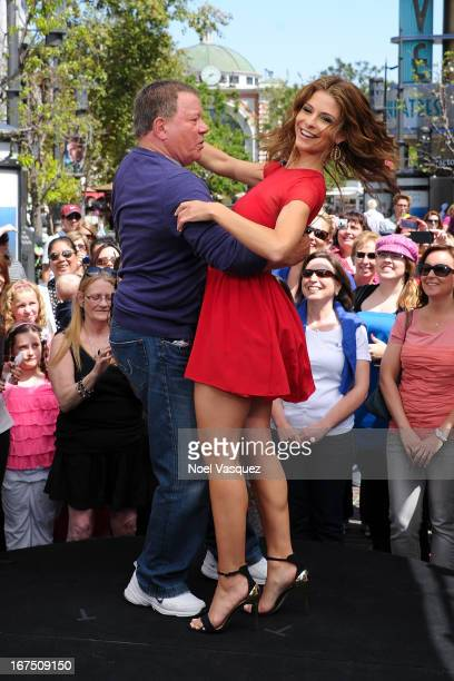 William Shatner and Maria Menounos dance together at 'Extra' at The Grove on April 25 2013 in Los Angeles California