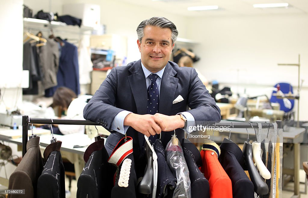 William Skinner, managing director of Dege & Skinner Ltd, poses for a photograph in the company's workshop on Savile Row in London, U.K., on Tuesday, July 2, 2013. New orders at manufacturers rose for a fourth month in June, led by the textiles clothing industry, while input costs fell for a third month. Photographer: Chris Ratcliffe/Bloomberg via Getty Images