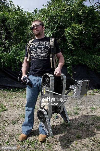 William Smith holding the SUGV 320 a portable military robot being used in Iraq is a Robot Wrangler for iRobot iRobot's most famous product is the...