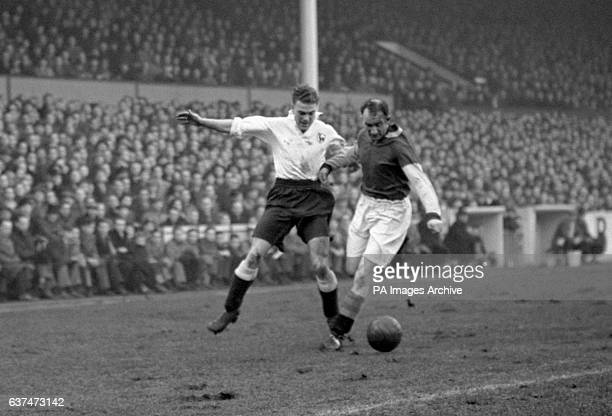 William 'Sonny' Walters of Spurs tangles with Aston Villa's Harry Parkes
