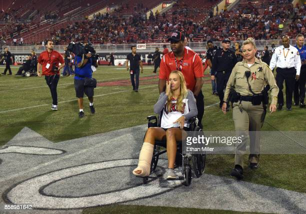 William St Clair wheels Addison Short who was injured in Sunday's mass shooting off the field during a pregame ceremony as her mother Las Vegas...