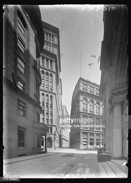 William Street looking north across Beaver Street with Delmonico's restaurant the Corn Exchange Building Lord's Court Building Seligman Company...