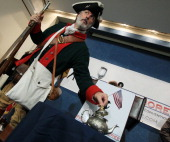 William Temple dressed in a colonial costume speaks in a news conference to condemn the GOP hosted by the Tea Party at the National Press Club on May...