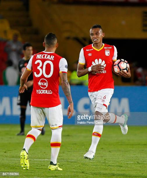 William Tesillo of Santa Fe celebrates after scoring the first goal of his team during a second leg match between Independiente Santa Fe and Libertad...