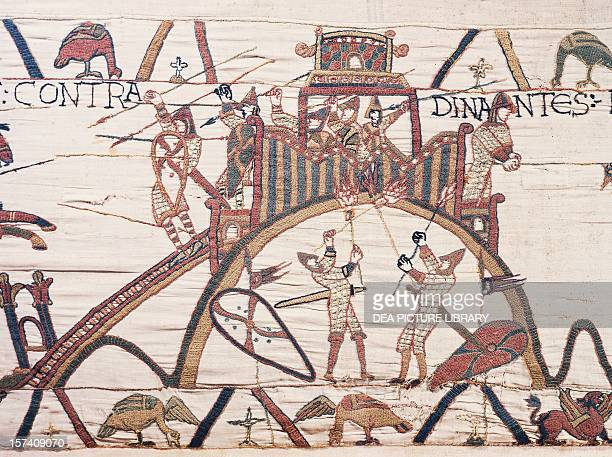 William the Conqueror's soldiers attacking the town of Dinan detail from the Bayeux tapestry or the Tapestry of Queen Matilda France 11th century