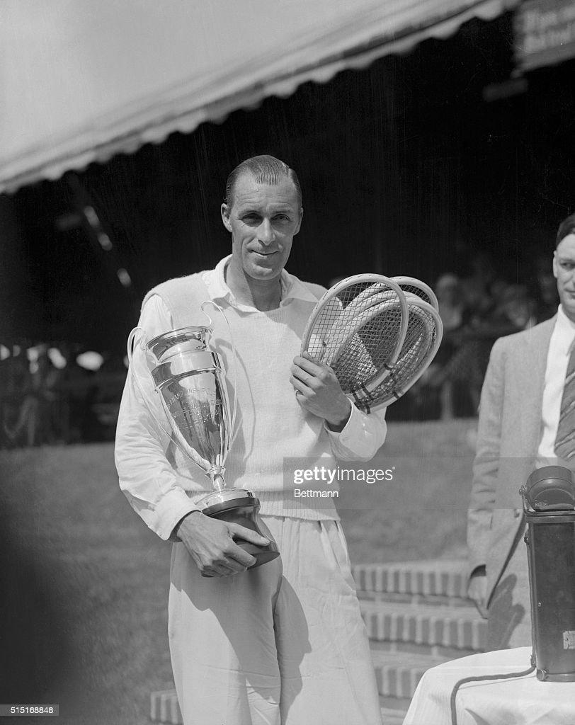 Bill Tilden Holding Trophy and Tennis Rackets