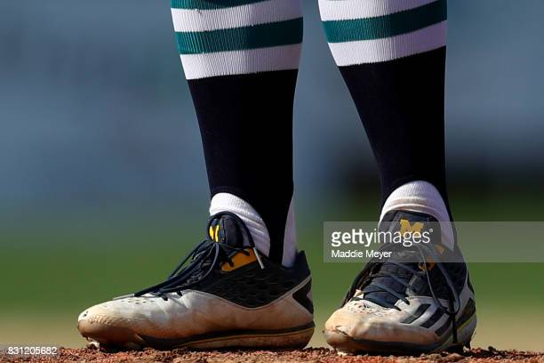 William Tribucher of the Brewster Whitecaps shows school spirit with his cleats adorned with the University of Michigan logo during game three of the...