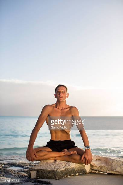 William Trubridge of New Zealand does yoga before his free dive at Suunto free diving world cup on November 24 2012 in Long Island Bahamas