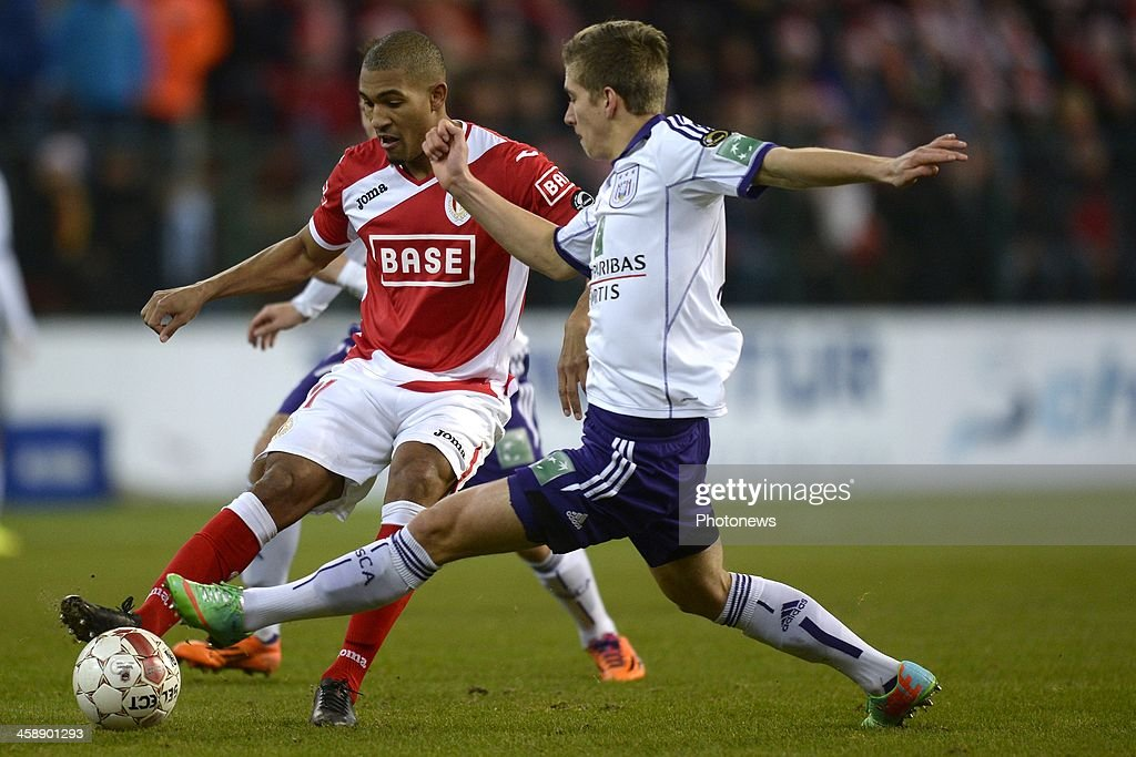 William Vainqueur of Standard battles for the ball with Dennis Praet of RSC Anderlecht during the Jupiler League match between Standard Liege and RSC Anderlecht on December 22, 2013 in Liege, Belgium.