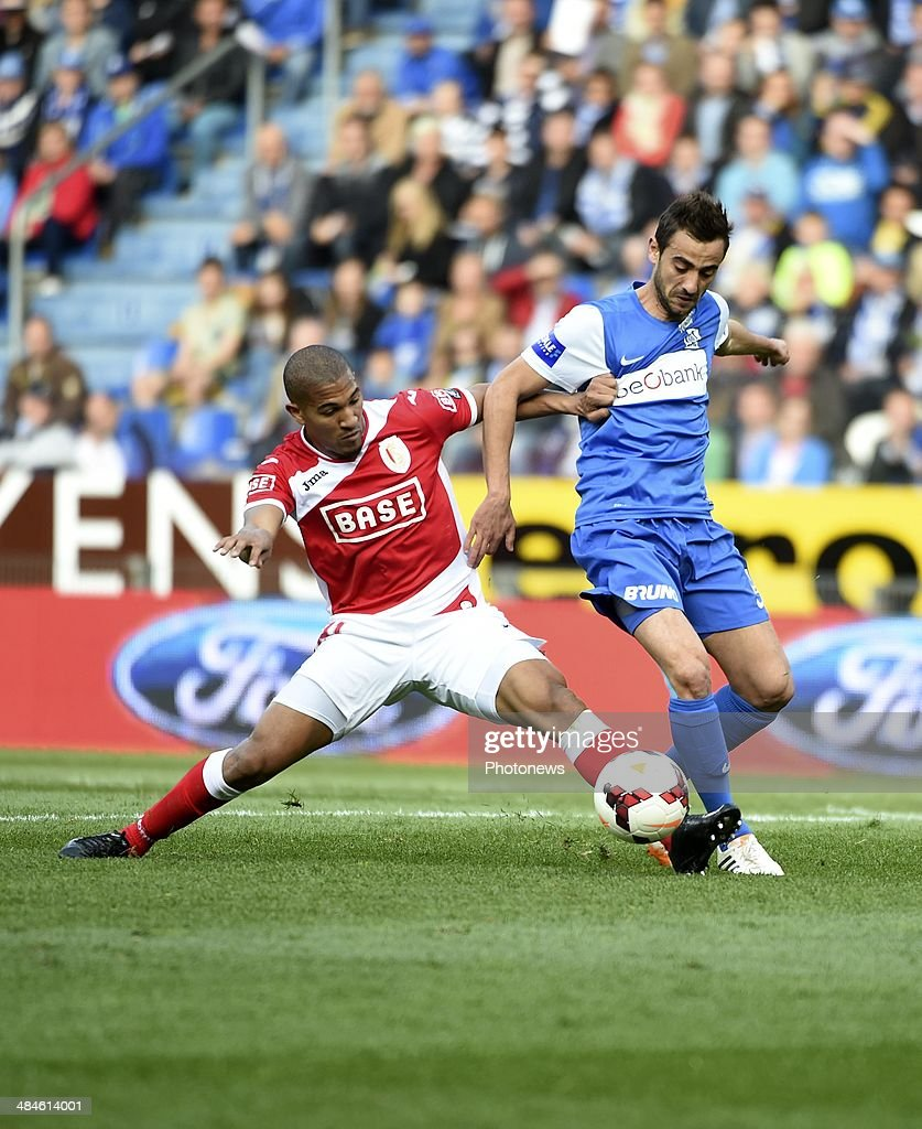 William Vainqueur of Standard Liege and <a gi-track='captionPersonalityLinkClicked' href=/galleries/search?phrase=Fabien+Camus&family=editorial&specificpeople=5702744 ng-click='$event.stopPropagation()'>Fabien Camus</a> of KRC Genk during the Jupiler Pro League - Play Off 1 match between KRC Genk and Standard de Liege in the Cristal Arena on April 13, 2014 in Genk, Belgium.