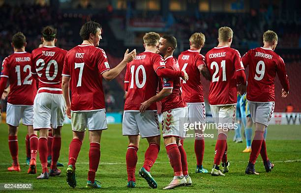 William Vitved Kvist Christian Eriksen and Riza Durmisi of Denmark celebrate after scoring their third goal during the FIFA 2018 World Cup Qualifier...