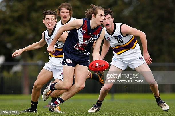 William Walker of the Dragons handballs the ball under pressure during the round 15 TAC Cup match between Sandringham and Murray at RAMS Arena on...