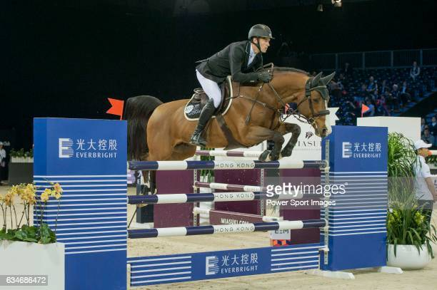 William Whitaker of United Kingdom riding Utamaro D Ecaussines competes during the AsiaWorldExpo Trophy part of the Longines Masters of Hong Kong on...