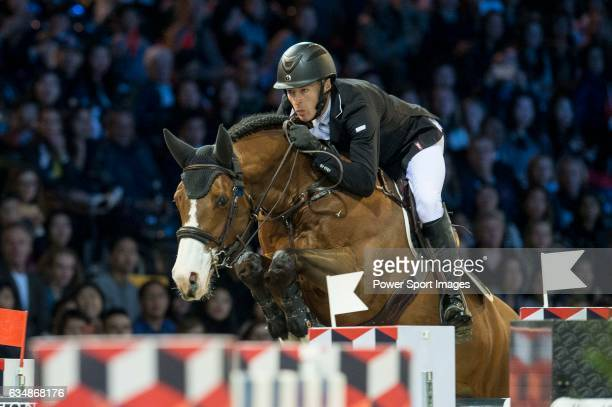 William Whitaker of United Kingdom riding Utamaro D Ecaussines competes during the Longines Grand Prix part of the Longines Masters of Hong Kong on...