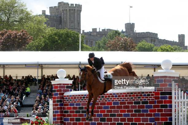 William Whitaker riding Cyber Space wins the St George Of England Puissance during the Windsor Horse Show at Windsor Castle in Berkshire