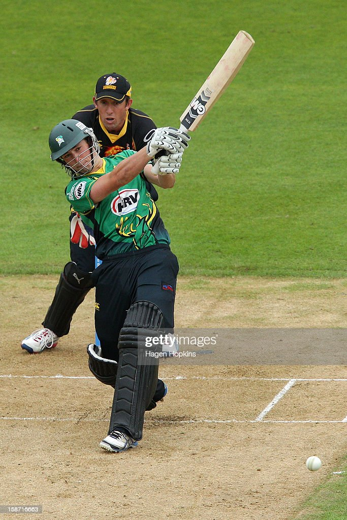 William Young of Central Districts bats while Luke Ronchi of Wellington looks on during the Twenty20 match between Wellington Firebirds and Central Stags at Hawkins Basin Reserve on December 26, 2012 in Wellington, New Zealand.