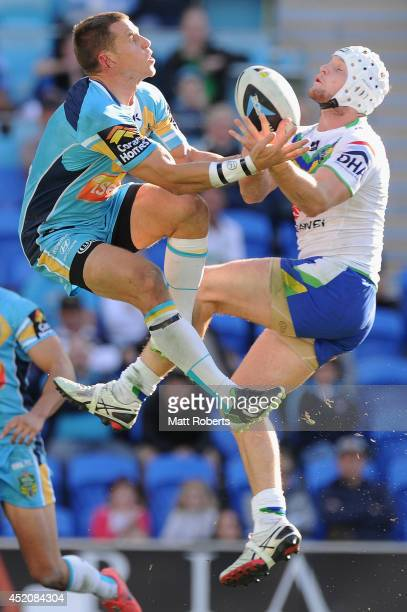 William Zillman of the Titans and Jarrod Croker of the Raiders compete for the ball during the round 18 NRL match between the Gold Coast Titans and...