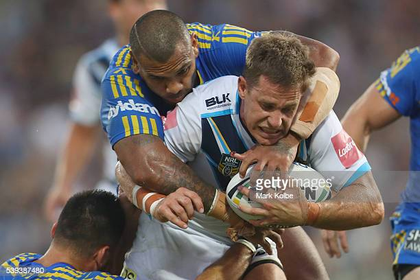 William Zillman of the Titans is tackled during the round 14 NRL match between the Parramatta Eels and the Gold Coast Titans at TIO Stadium on June...