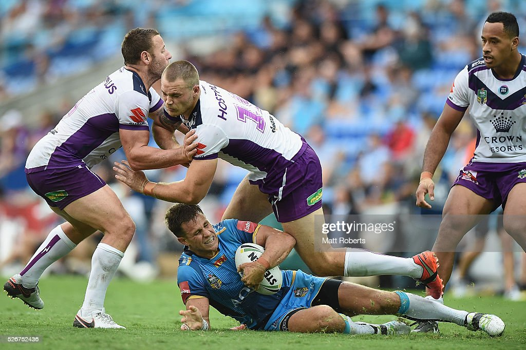 William Zillman of the Titans is tackled during the round nine NRL match between the Gold Coast Titans and the Melbourne Storm on May 1, 2016 in Gold Coast, Australia.
