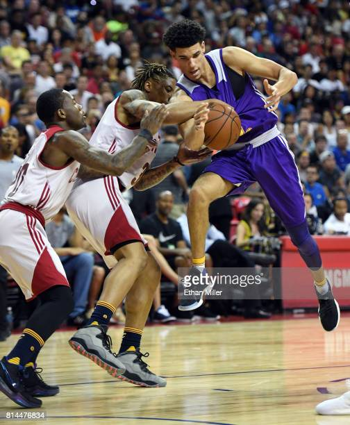 J Williams of the Cleveland Cavaliers ties up Lonzo Ball of the Los Angeles Lakers for a jump ball as Kay Felder of the Cavaliers defends during the...