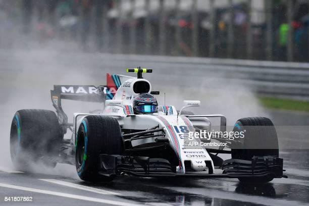 Williams' Canadian driver Lance Stroll drives as it rains during the third practice session at the Autodromo Nazionale circuit in Monza on September...