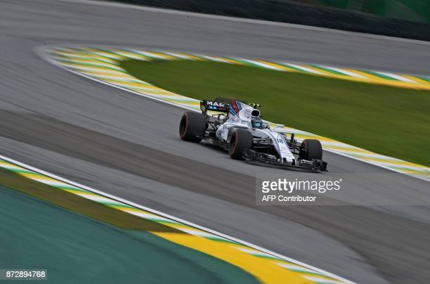 Williams' Canadian driver Lance Stroll powers his car during the Brazilian Formula One Grand Prix qualifying session at the Interlagos circuit in Sao...