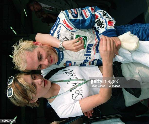 Williams driver Jaques Villeneuve with girlfriend Sandrine at Silverstone today where he is preparing for tomorrow's British Grand Prix Picture DAVID...
