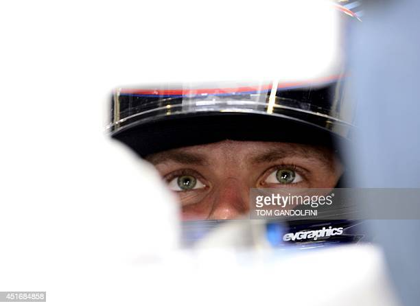 Williams' Finnish driver Valtteri Bottas looks at a control screen in the pits during the second practice session at the Silverstone circuit in...
