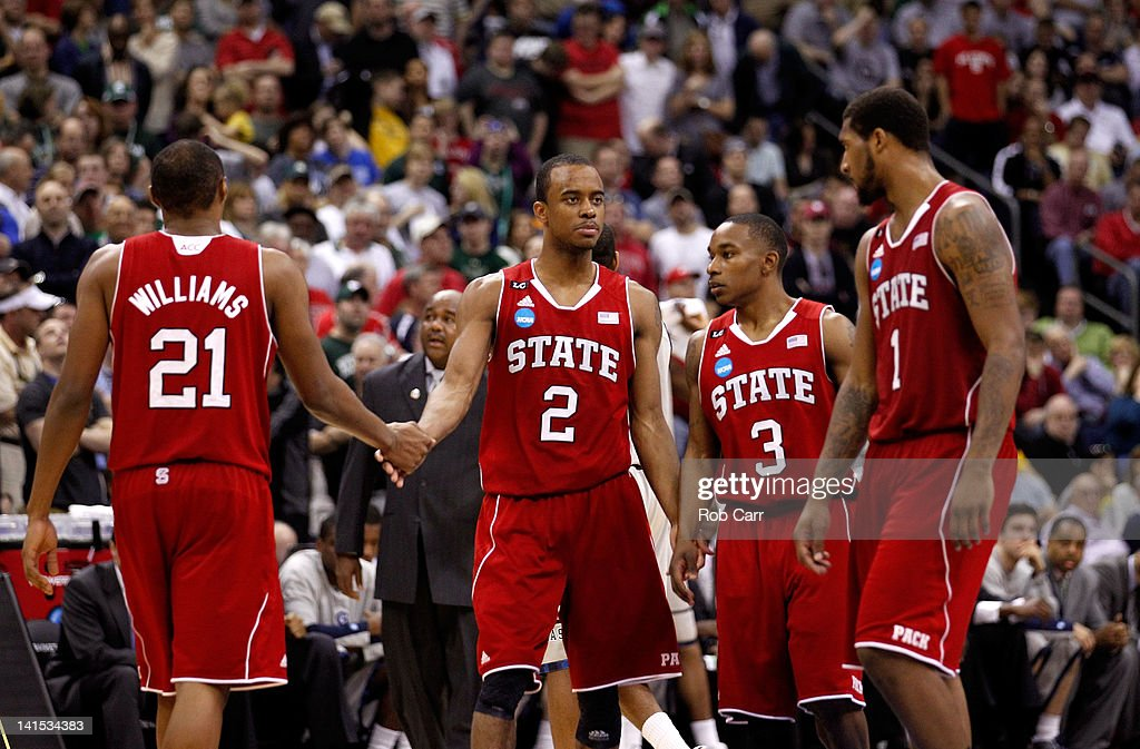 J Williams Lorenzo Brown Alex Johnson and Richard Howell of the North Carolina State Wolfpack react after a play late in the game against the...