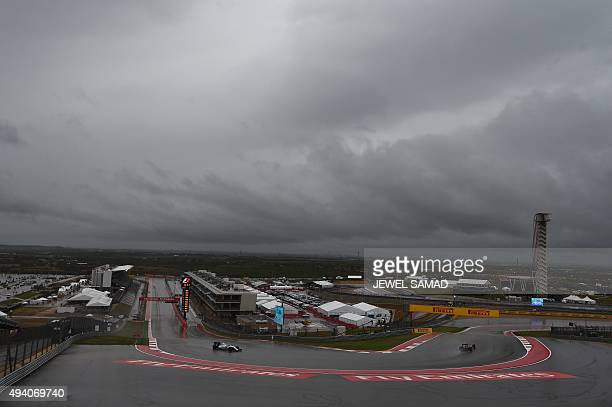 Williams Martini Racing Brazilian driver Felipe Massa races on the wet track during the third practice session ahead of the US Formula One Grand Prix...