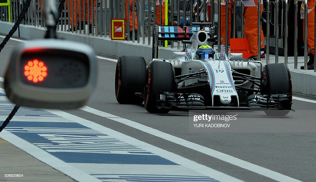 Williams Martini Racing's Brazilian driver Felipe Massa drives in the pits during the third practice session of the Formula One Russian Grand Prix at the Sochi Autodrom circuit on April 30, 2016. / AFP / YURI