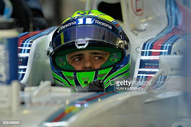 Williams Martini Racing's Brazilian driver Felipe Massa sits in his car during the third practice session of the Formula One Russian Grand Prix at...
