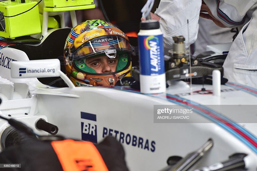 Williams Martini Racing's Brazilian driver Felipe Massa sits in his car at the Monaco street circuit, on May 29, 2016 in Monaco, ahead of the Monaco Formula 1 Grand Prix. / AFP / ANDREJ