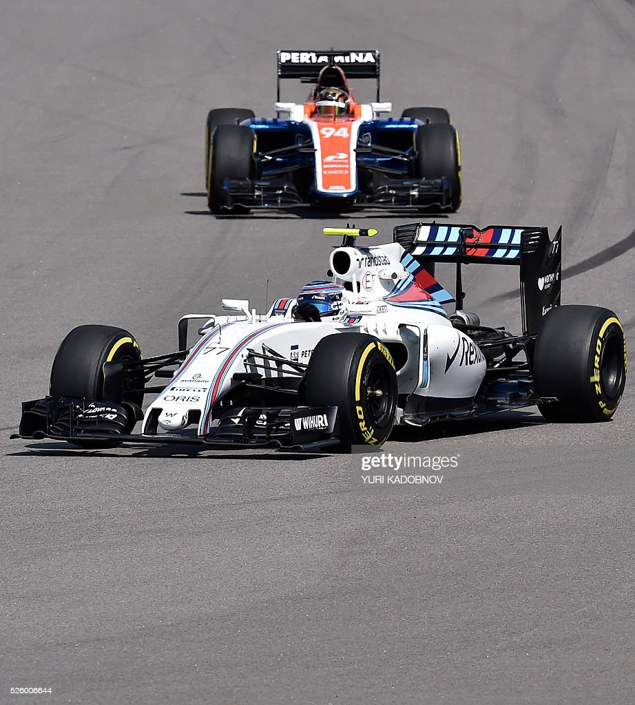 Williams Martini Racing's Finnish driver Valtteri Bottas (front) and Manor Racing MRT's German driver Pascal Wehrlein steer their cars during the second practice session of the Formula One Russian Grand Prix at the Sochi Autodrom circuit on April 29, 2016. / AFP / YURI