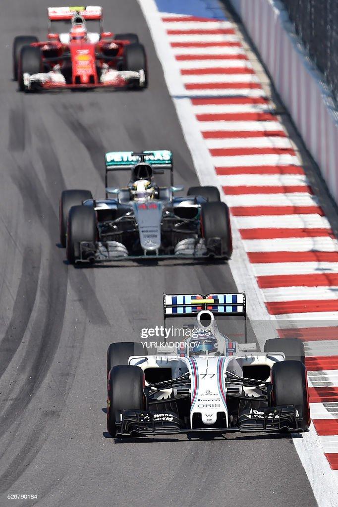 Williams Martini Racing's Finnish driver Valtteri Bottas leads Mercedes AMG Petronas F1 Team's British driver Lewis Hamilton and Scuderia Ferrari's Finnish driver Kimi Raikkonen during the Formula One Russian Grand Prix at the Sochi Autodrom circuit on May 1, 2016. / AFP / YURI