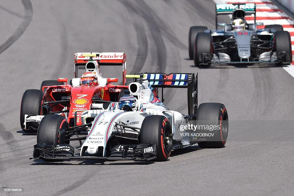 Williams Martini Racing's Finnish driver Valtteri Bottas leads Scuderia Ferrari's Finnish driver Kimi Raikkonen (L) and Mercedes AMG Petronas F1 Team's British driver Lewis Hamilton during the Formula One Russian Grand Prix at the Sochi Autodrom circuit on May 1, 2016. / AFP / YURI