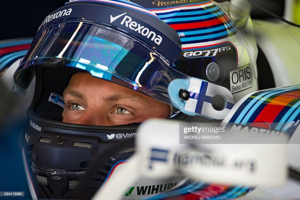 Williams Martini Racing's Finnish driver Valtteri Bottas sits in his car during the first practice session at the Monaco street circuit, on May 26, 2016 in Monaco, three days ahead of the Monaco Formula 1 Grand Prix. / AFP / ANDREJ