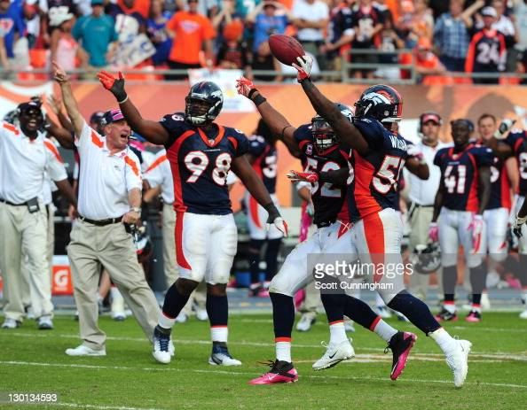 D J Williams of the Denver Broncos celebrates after recovering a fumble by Matt Moore of the Miami Dolphins at Sun Life Stadium on October 23 2011 in...