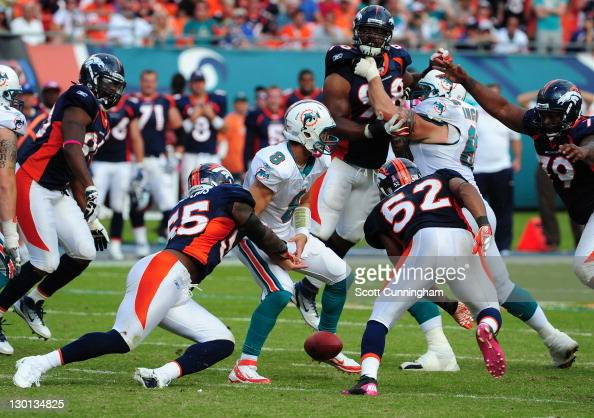 D J Williams of the Denver Broncos forces a fumble by Matt Moore of the Miami Dolphins at Sun Life Stadium on October 23 2011 in Miami Gardens Florida