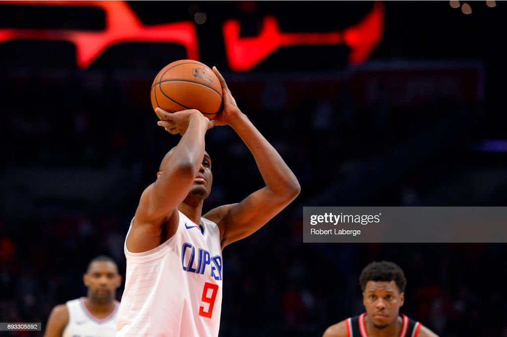 C. J. Williams #9 of the Los Angeles Clippers attempts a free throw against the Toronto Raptors on December 11, 2017 at STAPLES Center in Los Angeles, California.