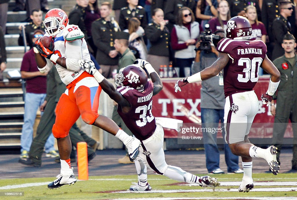 K.J. Williams #88 of the Sam Houston State Bearkats scores in the fourth quarer as he beats Michael Richardson #33 of the Texas A&M Aggies and Johntel Franklin at Kyle Field on November 17, 2012 in College Station, Texas.